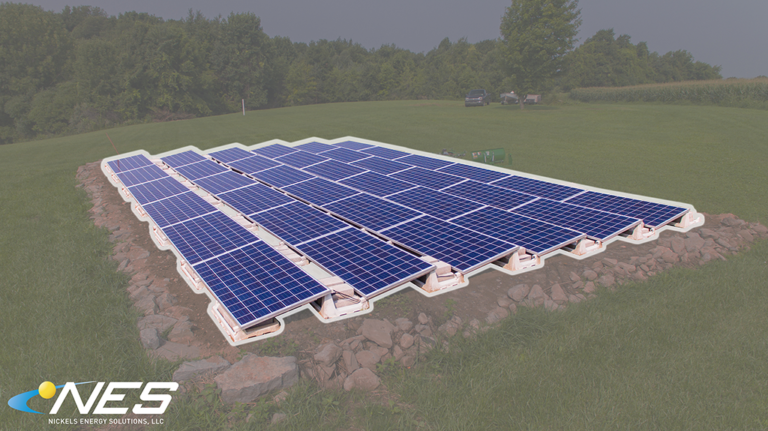 ballasted ground mounted solar panels in the middle of a field in marcellus ny